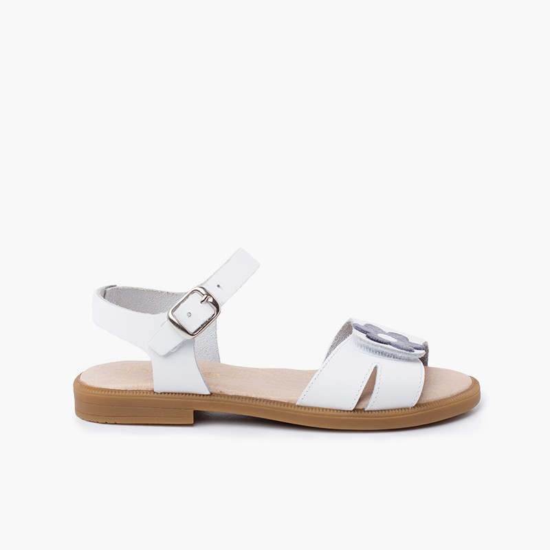 Wide strap adherent flower sandal with buckle closure