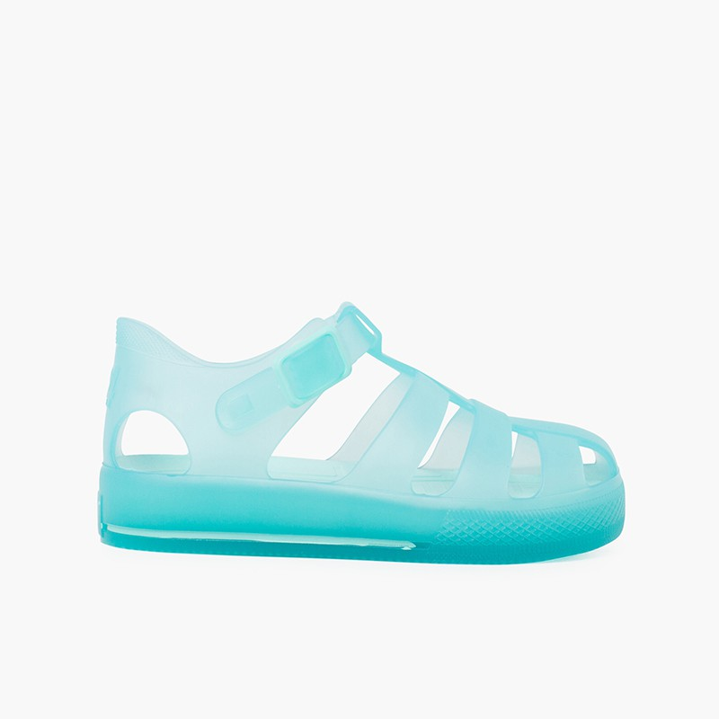 Tonal sole jelly sandals and clip button closure
