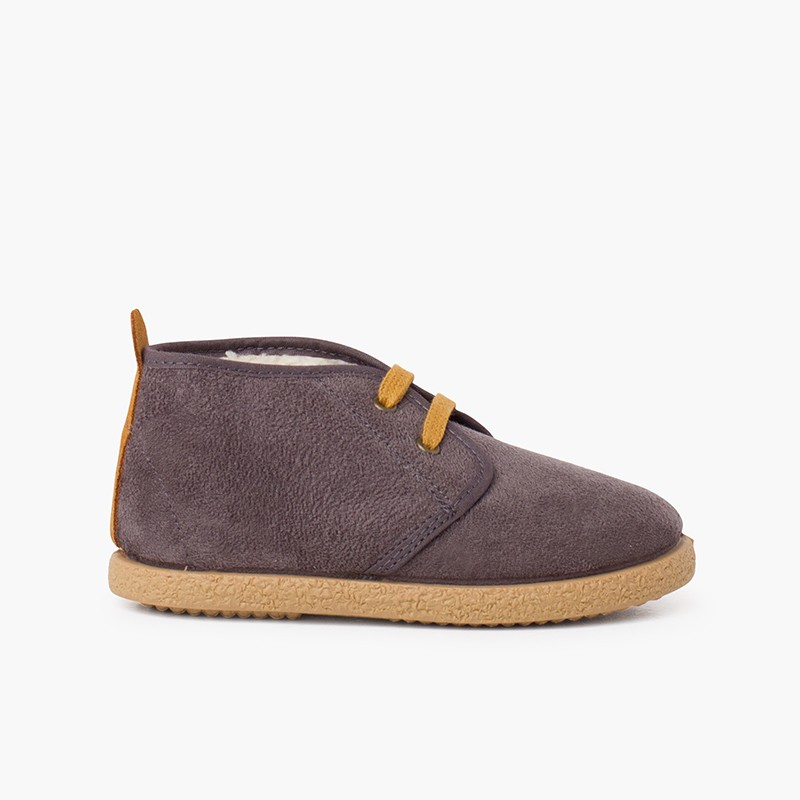 Shearling lining boots with camel back strip
