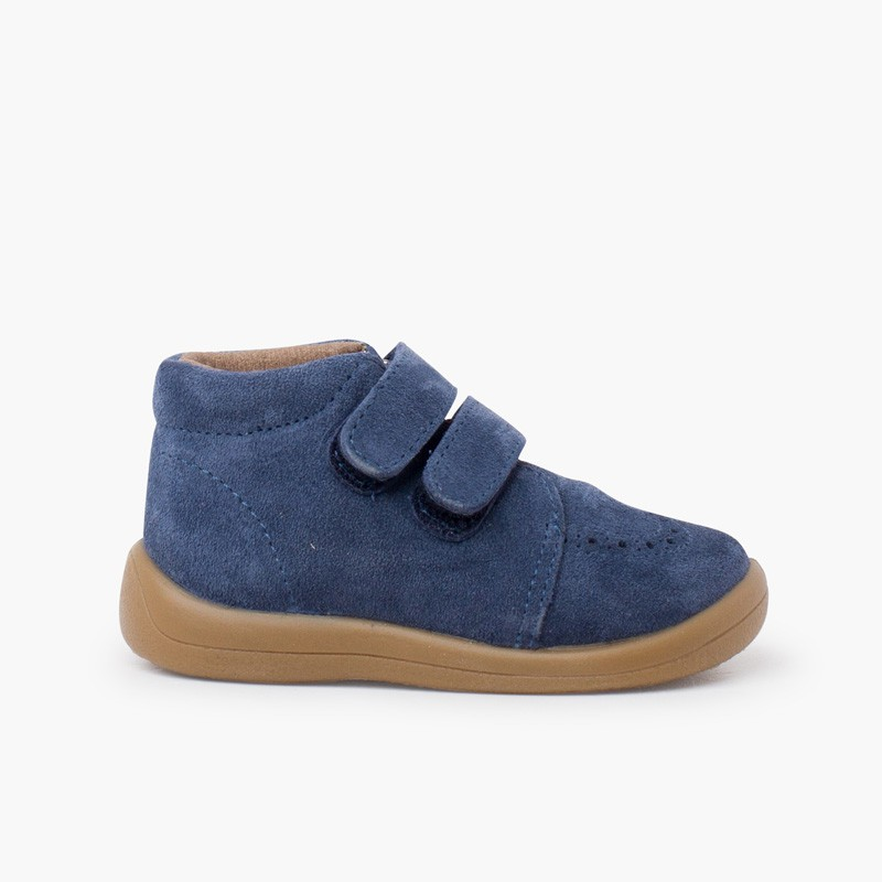 Suede booties with adhesive closure