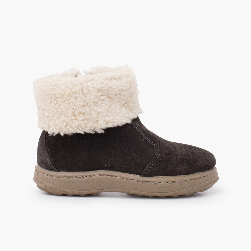 Sport sole boot with zipper and shearling